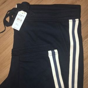 Skinny navy joggers with stripes down the side